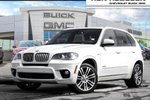 This White 4 door xDrive50i SUV features a Black interior a 8 Spd Automatic transmission, a  4.4L  V 8 engine, and has 73588 kilometres on it.