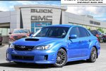 This Blue 4 door WRX 4dr Sedan Sedan features a Black interior a 5 Spd Manual transmission, a  2.5L  H 4 engine, and has 148521 kilometres on it.